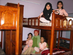 givelight-pakistan-dian-children-orphans-girls-bedroom 250x188